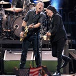 Bruce Springsteen and the E Street Band perform at Madison Square Garden on April 6, 2012 in New York City. Pictured are Max Weinberg, Bruce Springsteen and Stevie Van Zandt. Credit: Jamie McCarthy/Getty Images.