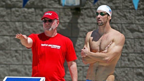 April 23, 2014; Mesa; Michael Phelps talks with his