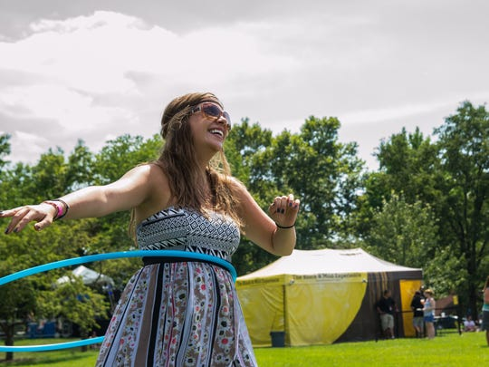 Nika Wolf from Clifton breaks from the pack at Warsteiner stage to hula hoop and listen to Panama Wedding.