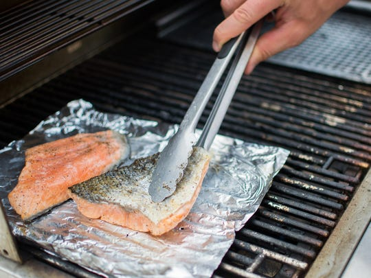 Using tongs, grab each filet long-ways to flip. If
