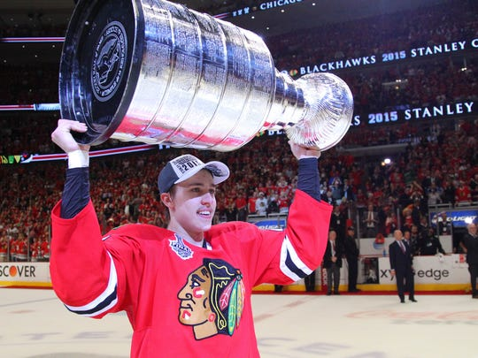 Chicago Blackhawks left wing Teuvo Teravainen (86) hoists the Stanley Cup after defeating the Tampa Bay Lightning in the Stanley Cup Final at United Center.