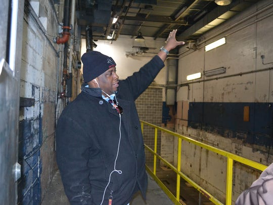 Carlos Dashiell, a pre-press operator at The Daily Times, tours the press room at the newspaper's old building on Carroll Street.