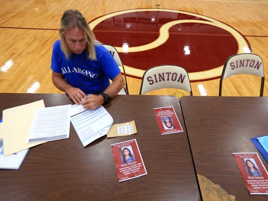 Mike Bryars fills out paperwork to donate blood during