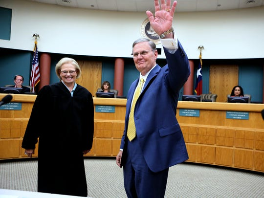 117th District Court Judge Sandra Watts (left) watches as Mayor Joe McComb waves to the crowd after taking the oath of office on Thursday, May 18, 2017 at City Hall.