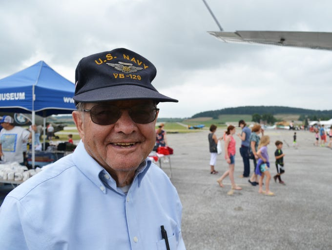 World War II Navy veteran John Wolfe smiles while talking