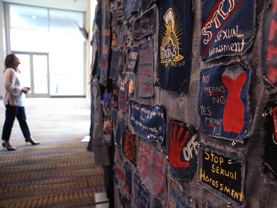 Judge Missy Medary views jeans with messages by students before the start of the Women's Shelter of South Texas' sixth annual Great Expectations Speaker Luncheon on Tuesday, June 27, 2017 at the American Bank Center.
