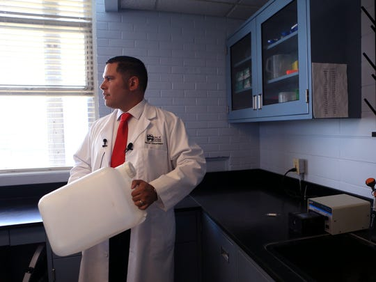 Gabriel Ramirez, assistant director of water quality and treatment in the utilities department for the City of Corpus Christi, explains the first step testing the DNA of water is collecting 20 liters of water during a public tour of the DNA laboratory at the O.N. Stevens Water Treatment Plant on Friday, July 28, 2017. Corpus Christi is the first municipal water system in the country to utilize DNA to analyze water.