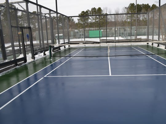 One of the platform tennis courts at Manklin Meadows Racquet Sports Complex in Ocean Pines. Platform tennis courts were originally built on a platform housing heating elements to melt snow and ice for winter play.