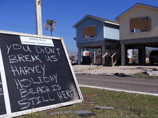 A sign for residents entering Holiday Beach tells residents the Hurricane Harvey didn't break the community on Aug. 30, 2017. Homes sustained major damage from Hurricane Harvey.