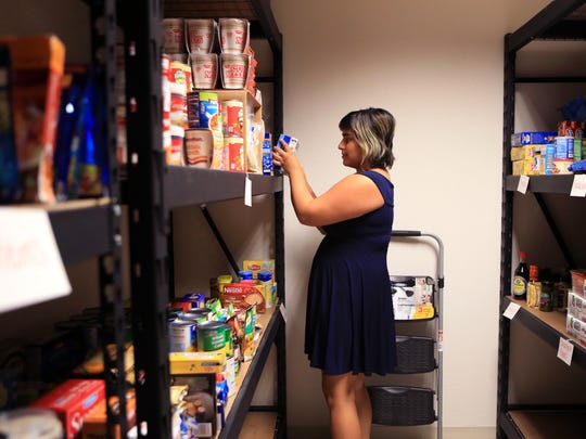Friederike Davis, vice-president for student government at Texas A&M University-Corpus Christi, organizes donated food for Izzy's Food Pantry at the university last month. The food pantry will help students with food needs on campus.