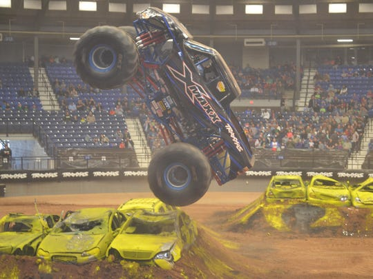Driver Jeff Murphy takes a turn in the vertical wheelie competition at the Traxxas Monster Truck Show.
