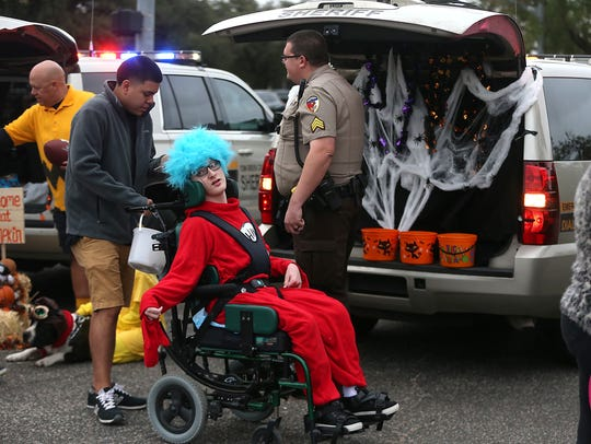 Trick-or-treaters make the rounds for candy during