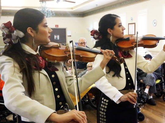 Mariachi Estrella performs for Leobardo Hernandez Saturday.