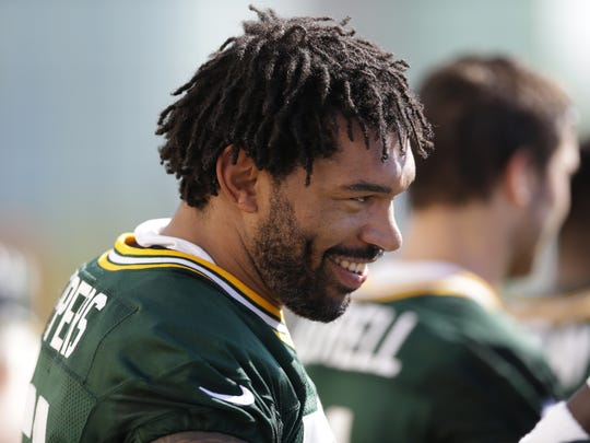 Green Bay Packers linebacker Julius Peppers (56) smiles during training camp practice on July 26, 2016, at Ray Nitschke Field.