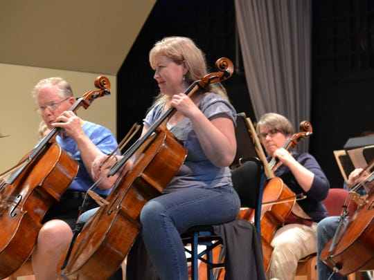 Members of the Lakeside Symphony Orchestra practice