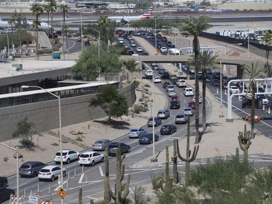 Traffic slows outside Terminal 4 after its closure at Sky Harbor Airport in Phoenix on Sept. 16, 2018.