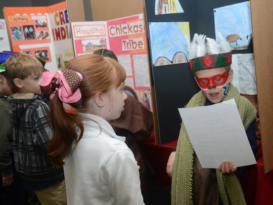 Peabody Montessori Elementary School pupil Tyler Harper (right) discusses his project on the Ioway Indians (Baxoje) with Chloe Jenkins Tuesday, Nov. 18, 2014.-Melinda Martinez/mmartinez@thetowntalk.com, The Town Talk, Gannett