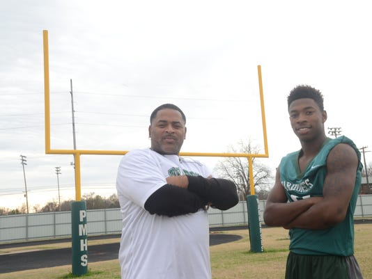 ANI All Cenla Football Coach and MVP player Peabody football coach Toriano Williams (left) and Peabody junior quarterback Sadrick Kirklin were selected Coach of the Year and All-Cenla MVP. Thursday, Dec. 11, 2014.-Melinda Martinez/mmartinez@thetowntalk.com
