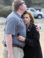 Eric Mueller hugs his mother, Marsha, during a playground