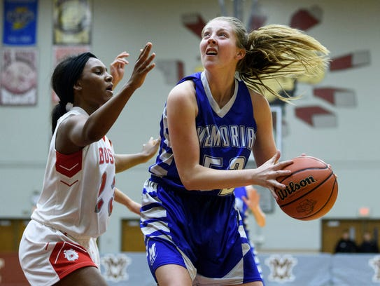 Memorial's Mallory Housman (52) drives to the basket