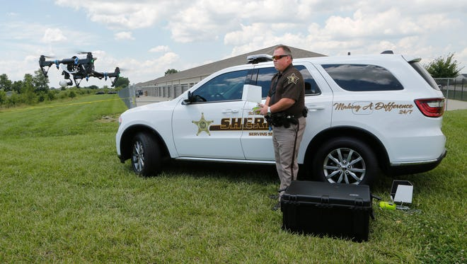 Deputy Rob Rush of the Tippecanoe Sheriff's Office with a drone to help gather evidence following the discovery of a body found in a drainage  ditch Monday, July 31, 2017, behind Promenade Self Storage, 3700 Promenade Parkway on the south side of Lafayette.