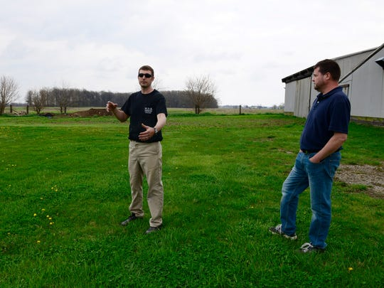 Michael Kessler, left, and Chris Zeman talk about proposed wind turbines at Kessler's Seneca County home. Both men are opposed to proposed wind energy development in their area.