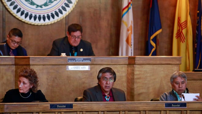 Navajo Nation Council Delegate Leonard Tsosie, center, presents his bill funding various water and wastewater projects in communities across the reservation to the council at the winter session on Thursday in Window Rock, Ariz.
