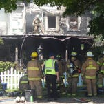 A fire took over a 100-year-old home on the 300 block of South Walnut Street in Howell on Saturday.