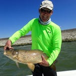 Bill Woodward is pictured with his 29-inch carp at Jackson Reservoir on June 27.