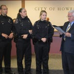 Howell Mayor Nick Proctor, far right, presented city officers, from left, Derek Burke, Renae Small and Aleshia Vallance with a Lifesaving Award in January for their effort in saving a 77-year-old woman from her burning home.