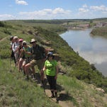 Hikers walk on Rogers Mountain on a Get Fit Great Falls in 2015.