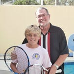 Photographer and tennis enthusiast John Thawley of Village Walk with his favorite photo of his favorite player Roger Federer.