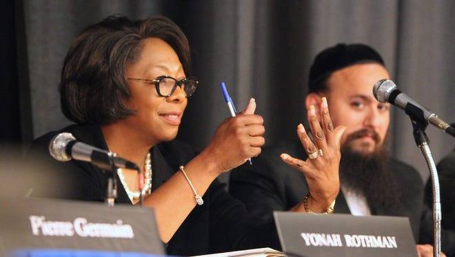 East Ramapo Schools Superintendent Deborah Wortham and Board President Yehuda Weissmandl listen to an auditor's report  during a board meeting earlier this month at Ramapo High School.