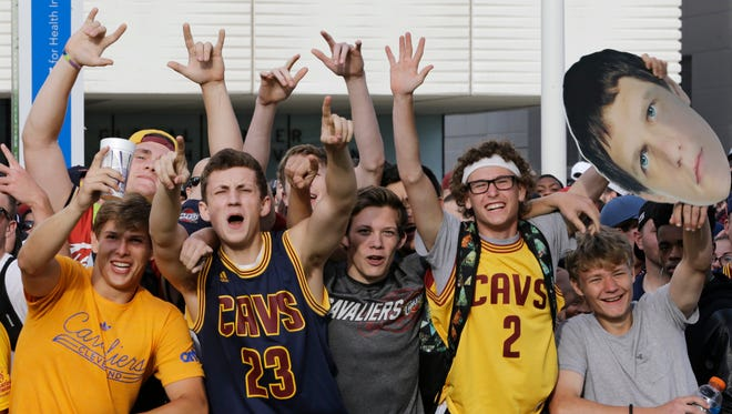 Cavaliers fans wait for the parade to begin Wednesday in Cleveland.