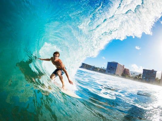 Surfer Gettting Barreled