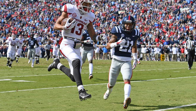 Arkansas wide receiver Deon Stewart (13) runs past Mississippi defensive back Javien Hamilton (21) for a 23-yard touchdown reception during the first half of an NCAA college football game in Oxford, Miss., Saturday, Oct. 28, 2017. (AP Photo/Thomas Graning)