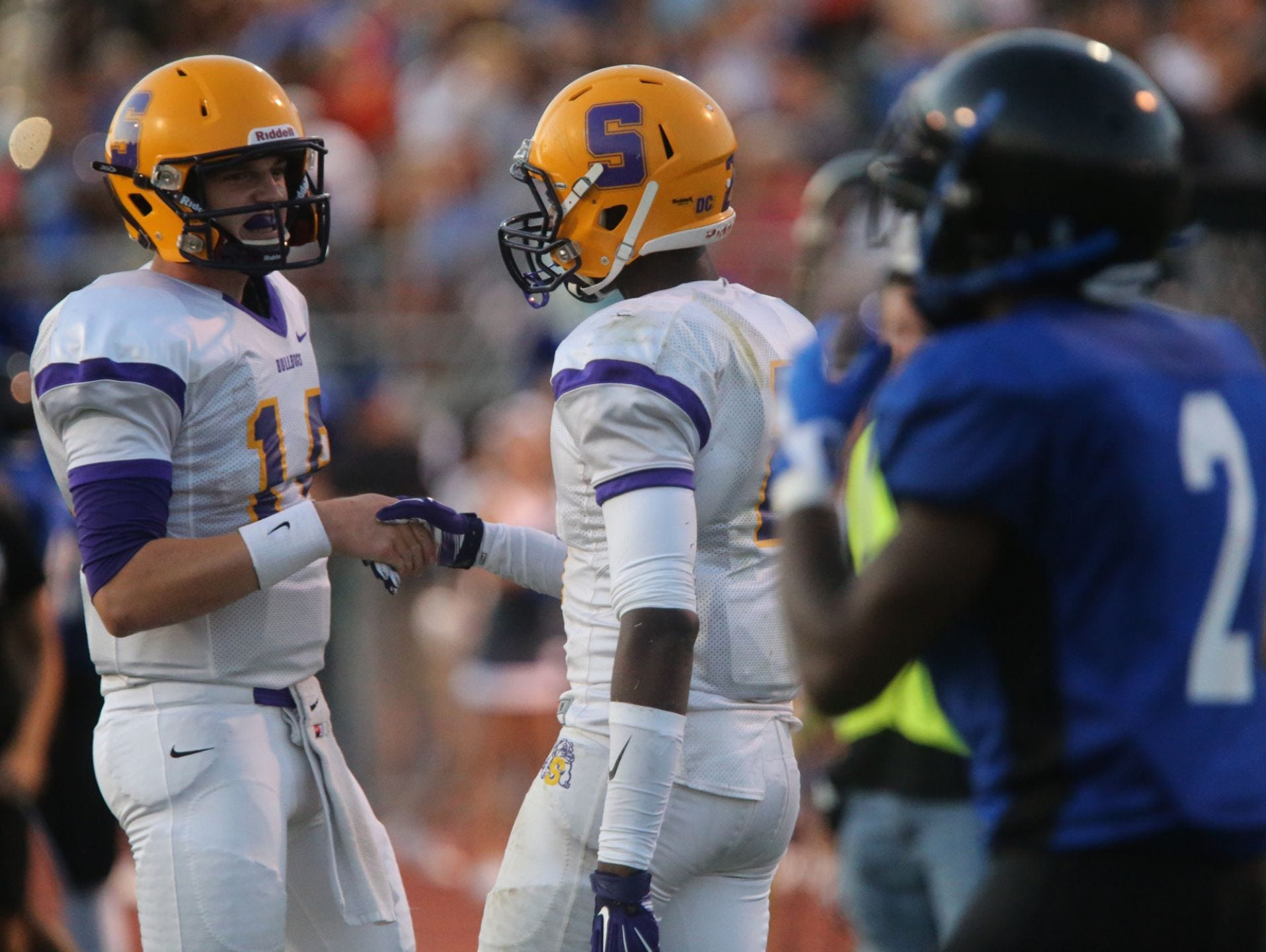 Smyrna quarterback John Turner (left) has thrown for 1,093 yards and four touchdowns this season.