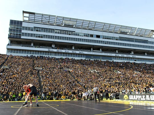 Iowa and Oklahoma State gave wrestling a boost at Grapple on the Gridiron Saturday.