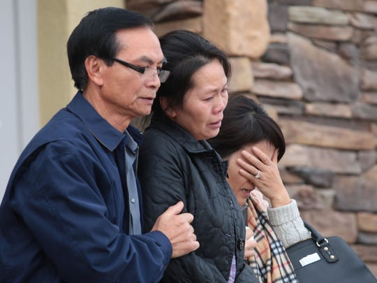The family of shooting victim Tin Nguyen leave the county site for victims of yesterday's shooting in San Bernardino.