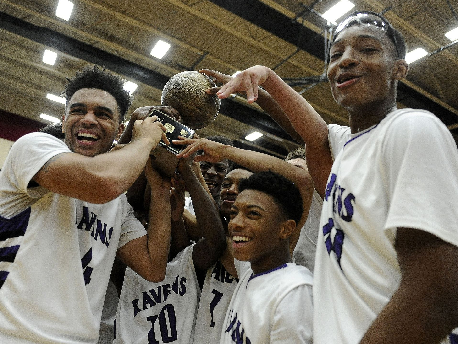 Cane Ridge players celebrate after the team's doubble-overtime win over Hillsboro on Friday.