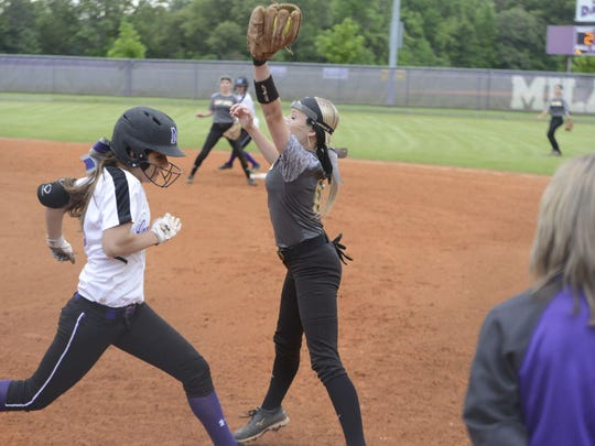 Scotts Hill's Cassie McBride makes a catch at first base to retire a Milan batter.