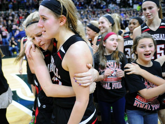 Marshall's Nikki Tucker (right) is hugged by her sister and teammate, Natalie Tucker, following the 2016 Class B State Semifinal at Michigan State University.