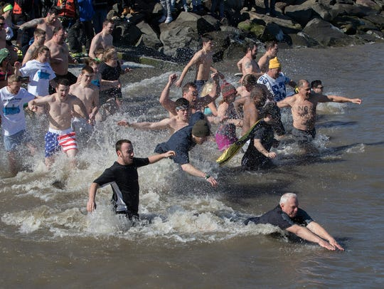 Participants in the 10th Annual Penguin Plunge entered