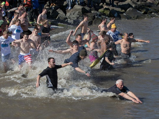 Participants in the 10th Annual Penguin Plunge entered the frigid Hudson River at Memorial Park on Sunday in Nyack
