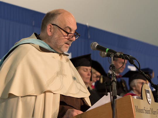 Fr. Francis Amodio, Chaplain and Director of Campus Ministry, delivers the Invocation at the 54th Annual Commencement Ceremonies at Mount Saint Mary College on Saturday, May 20 in Newburgh.