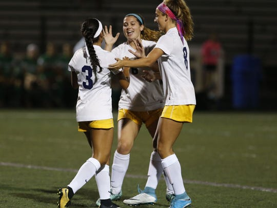 Maria Karagiannakis (3) of Toms River North celebrates with teammates after scoring a goal Brick during girls high school soccer game at Toms River North High School, Toms River,NJ. Monday, October 9, 2017. Noah K. Murray-Correspondent Asbury Park Press  Noah K. Murray, Noah K. Murray-Correspondent Asb