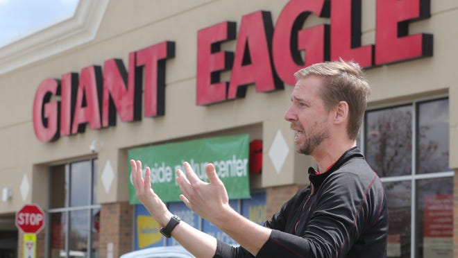 Giant Eagle spokesman Dan Donovan is pictured in April outside the Howe Avenue Giant Eagle store in Cuyahoga Falls. An employee at the Portage Crossing Market District store in the Falls tested positive for COVID-19 July 16.