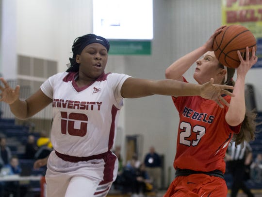 Saddle River Day's Michelle Sidor goes up with a shot as University's Tanisha Tucker runs by. University High vs Saddle River Girls Basketball in NJSIAA quarterfinal game at Toms River on March 14, 2018