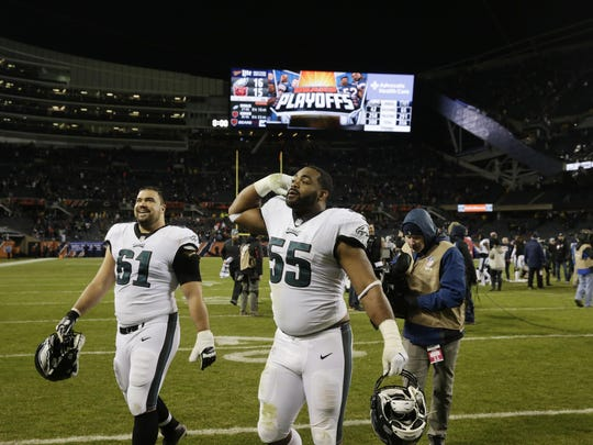 Eagles defensive end Brandon Graham (55) and offensive guard Stefen Wisniewski (61) celebrate after a wild-card win over the Bears.