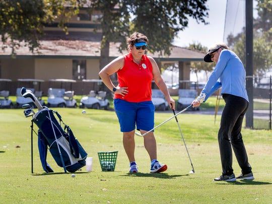 Kate Morales-O'neil gives a lesson to Mary Murray, right, and Carol Olincy at Valley Oaks Golf Course.